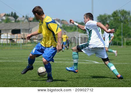KAPOSVAR, HUNGARY - JUNE 11: Martin Pastrovics (L) in action at the Hungarian National Championship under 13 game between Kaposvari Rakoczi FC and Bajai LSE June 11, 2011 in Kaposvar, Hungary.