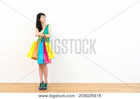 Lovely Female Shopper Standing On Wooden Floor