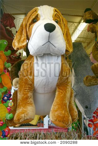 Such a Big stuffed dog for someone to win at the carnival. poster
