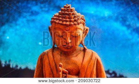 Buddha meditation figure below the starry night
