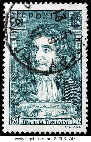 LUGA RUSSIA - OCTOBER 6 2017: A stamp printed by FRANCE shows image portrait of Jean de La Fontaine - a French fabulist and one of the most widely read French poets circa 1938