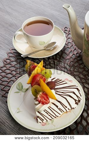 Slice Of Delicious Tart With Fresh Fruits