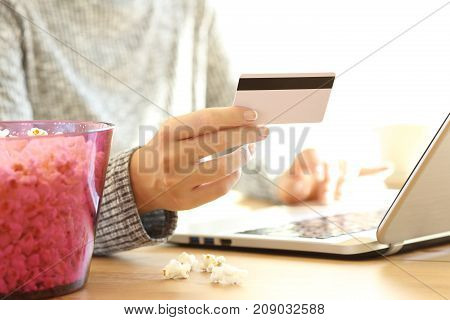 Woman Hand Buying Movies On Line In A Laptop