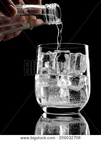 Bottle Of Soda Mineral Water Pouring Into Glass