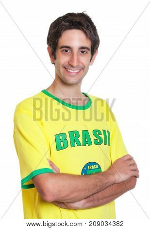 Brazilian man with short black hair and crossed arms on an isolated white background for cut out