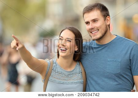 Happy Couple Finding Location And Pointing On The Street