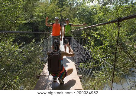 Travel adventure and hiking activity active and healthy lifestyle on summer vacation and weekend tour. Tourist With Backpacks travel. tourist takes pictures