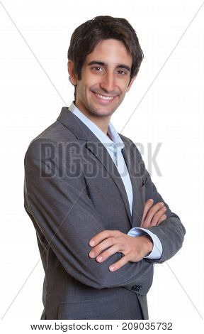 Modern latin businessman with suit and short hair on an isolated white background for cut out