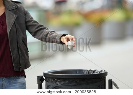 Lady Hand Throwing Garbage To A Trash Bin