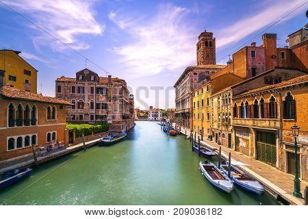 Venice canal in Cannaregio and San Geremia church landmark. Italy. Long exposure photography.