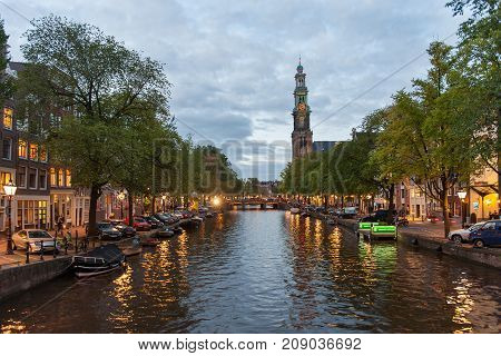 A canal and the Westerkerk church in Amsterdam, Netherlands