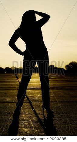 Woman Silhouetted At Sunset.