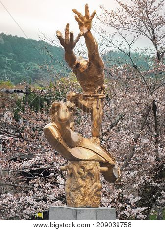 Keage Incline, Kyoto, Japan - April 5, 2017 : Gold figure sculpture installed in front of keage incline railway station. Landmark for spring scenery of amazing cherry blossoms in Kyoto