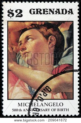 LUGA RUSSIA - OCTOBER 6 2017: A stamp printed by GRENADA shows fragment of panel painting Doni Tondo or Doni Madonna by Michelangelo Buonarroti circa 1975