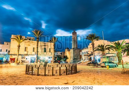 Night photo of street with Ribat castle in Sousse. Medieval architecture in night lights. Vivid picture of ancient religious building - one of the main attractions in Sousse, Tunisia.