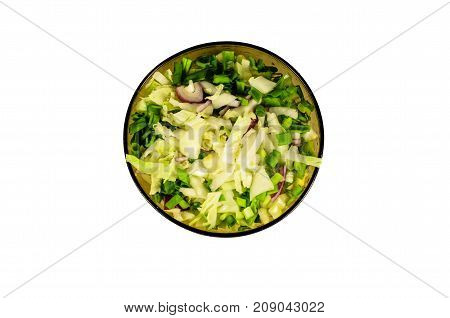 Salad with chinese cabbage and green onion isolated on white. Top view