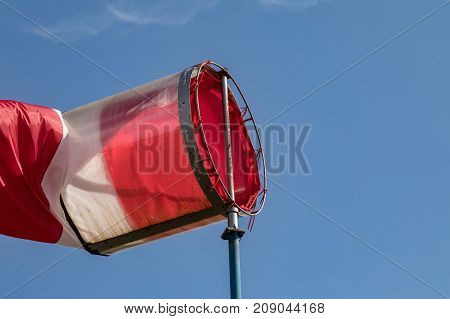 Airport windsock on clear blue sky background in windy weather indicate the local wind directionair sock drogue wind sleeve wind cone