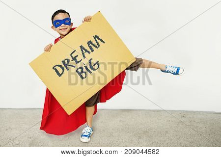 Boy holding  asign with Dream Big
