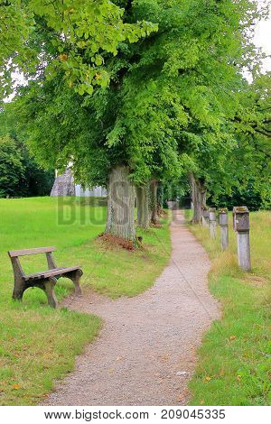 The picture was taken in Germany in the oldest monastery Weltenburg. The picture shows a quiet alley in the old monastery park.