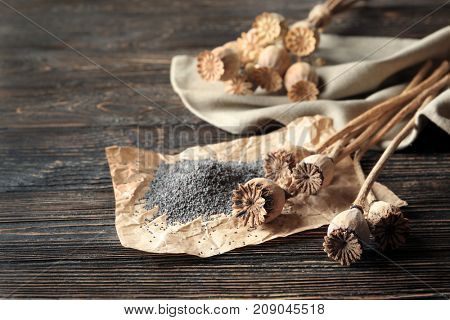 Poppy heads and seeds on table