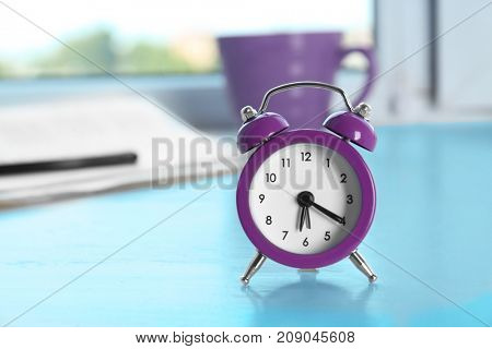 Alarm clock on window sill. Morning routine concept