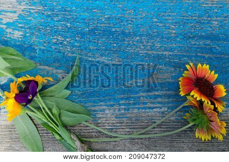 Flowers perimeter on a wooden painted board with cracks texture background wallpaper