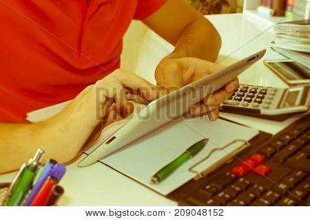 The calculators ipad business owners accounting and technology business computer ipad calculator and documents in the office - Retro color