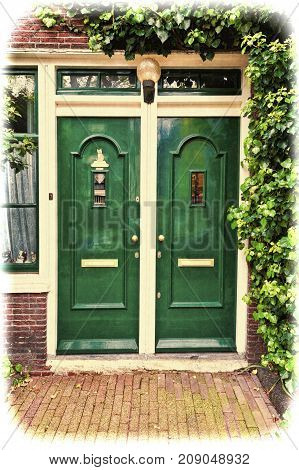 Painted door of the traditional house in Amsterdam. Brick facade of the old city house in Holland. Vintage style toned picture