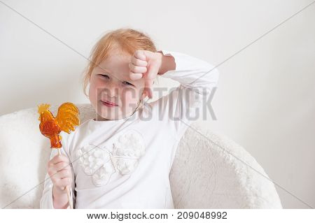 Girl with disgust face does not like candy