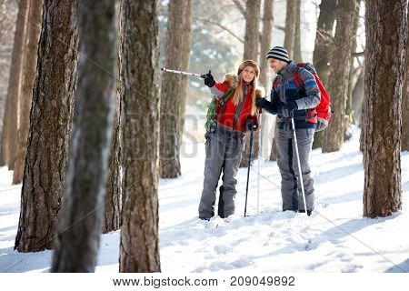 Girl show right way to boyfriend in forest
