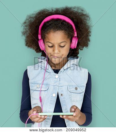 Little Girl Headphones Using Phone