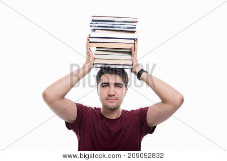 Handsome Student Holding Pile Of Books Over His Head