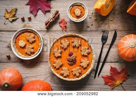 Homemade Thanksgiving Day Pumpkin Pies On Wooden Table