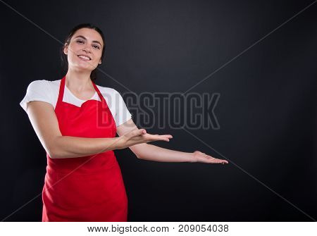 Happy Female With Red Apron Invinting You In