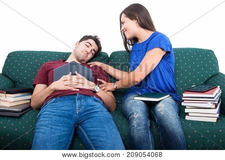 Student Girlfriend Awaking Boyfriend Napping On Couch