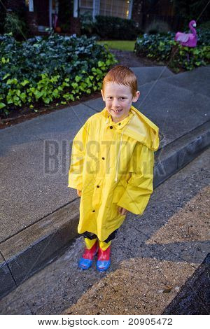 Young Boy Playing In The Rain