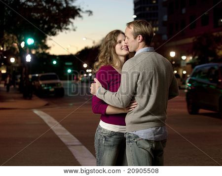 Caucasian Couple Kissing In Street