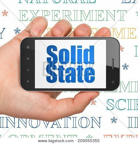 Science concept: Hand Holding Smartphone with  blue text Solid State on display,  Tag Cloud background, 3D rendering