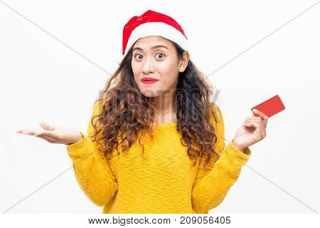 Happy pretty woman getting discount in shop and looking surprised. Amazed young lady paying purchase with credit card. Christmas sale concept