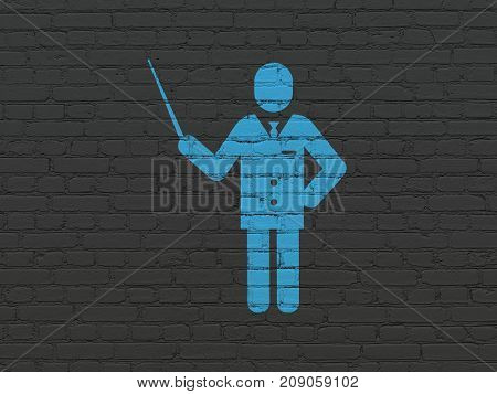 Learning concept: Painted blue Teacher icon on Black Brick wall background