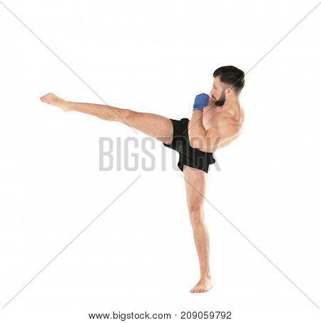 Male kickboxer on white background