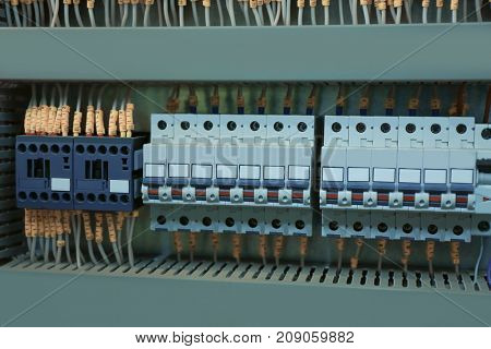 View of automatic circuit breakers in distribution board, closeup