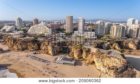 Aerial. The city of Portimao shot by drones, view from the sky.