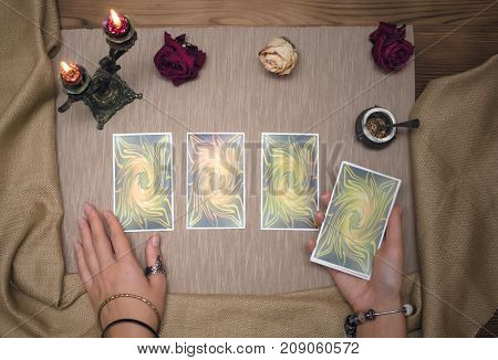 Tarot cards on wooden desk table of fortune teller. Tarot reading.