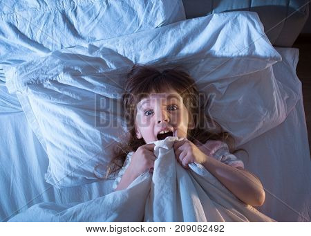 The Girl Is Terrified Lying In Bed