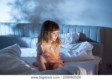 The Girl Feels The Indignation And Sits On The Bed
