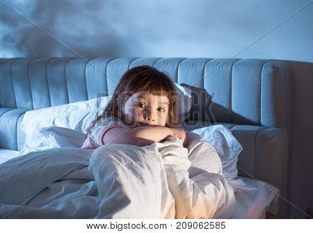 The Child Is Afraid Of Lying In Bed At Night