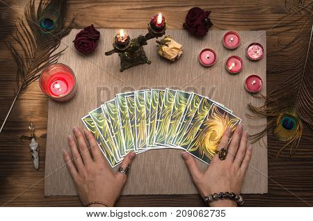 Fortune teller reading future with tarot cards. Paranormal desk table.