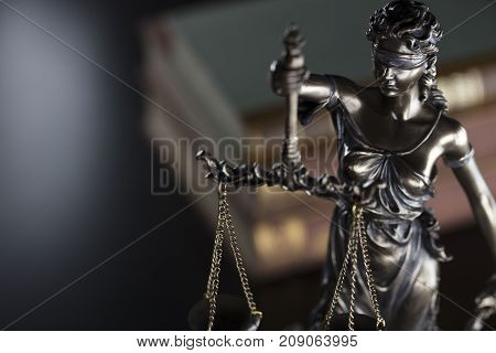 Court library - statue of justice and books.