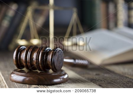 Law and justice theme. Mallet of judge and scale of justice. Legal code.